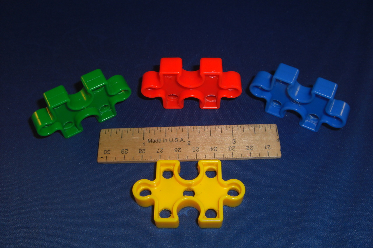 7 Hole Drilled Plastic Puzzle Piece